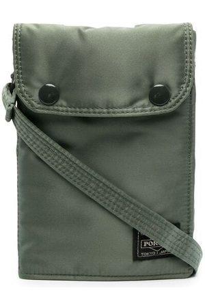PORTER-YOSHIDA & CO Metallisk messenger-taske med logomærke