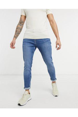 Bershka Jeans i mørkeblå vask i super skinny fit