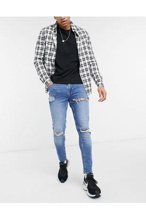 ASOS Skinny jeans i mellemvasket med kraftige rifter fra