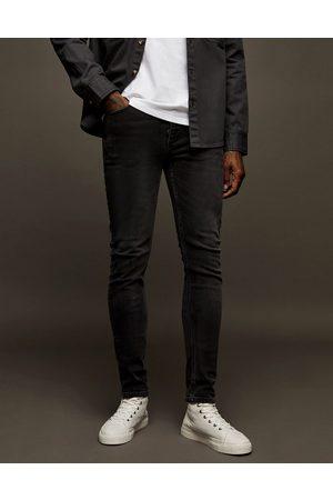 Topman Elastiske skinny-jeans i vasket sort