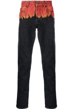 MARCELO BURLON Jeans med smal pasform og flammetryk