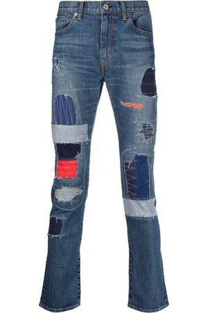 JUNYA WATANABE Jeans med patchwork og smal pasform