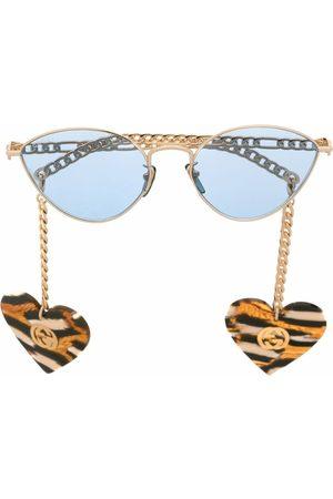 Gucci Cat-eye solbriller med hjertevedhæng