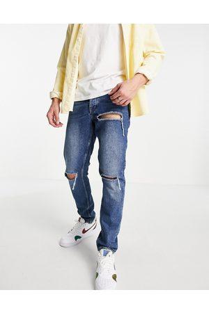 ASOS Smalle jeans i vintage mørk vask med huller-Blå