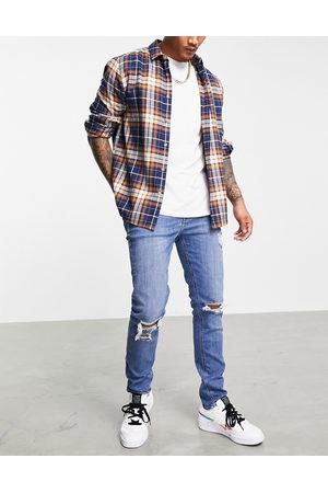 ASOS Medium forvaskede skinny-jeans med flænser på knæene