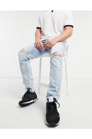 AMERICAN EAGLE Jeans med slidt look i skinny fit og lys vintagevask