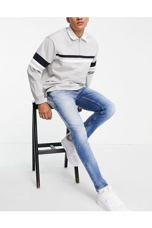Tommy Hilfiger Austin - Lyseblå jeans i slim fit