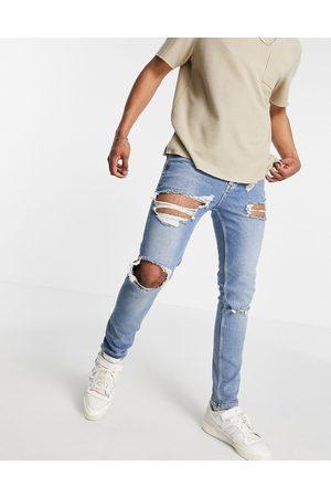 ASOS Skinny-jeans med huller og slidt kant i vintage mellemvasket blå