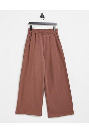 ASOS Oversized joggingbukser med vide ben i vasket brun - Del af sæt