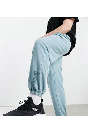 PUMA Plus - Oversized joggingbukser i forvasket blå - Kun hos ASOS