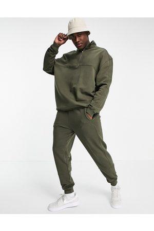 ASOS Træningssæt med sweatshirt med halv lynlås og skinny-joggingbukser-Grøn