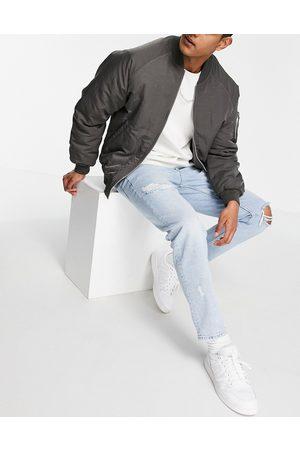 ASOS Tapered jeans i lys 90'er-vask med huller-Blå