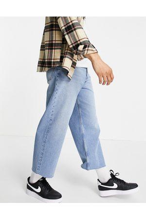 ASOS Cropped jeans med brede ben i 90'er blå vask med rå kant