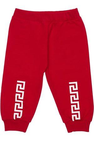 VERSACE Printed Jersey Sweatpants