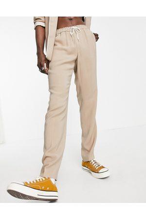 ASOS Kamelbrune pyjamas-habitbukser i slim fit med kanter på lommerne-Neutral