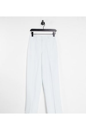 COLLUSION Unisex - Lavtaljede bukser med lige ben i isblå-Multifarvet