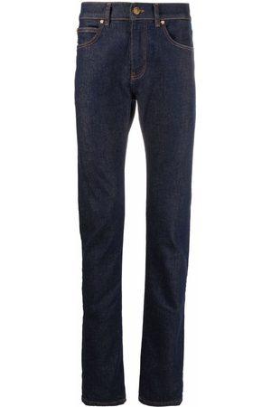 VERSACE Contrast-stitch slim-cut jeans