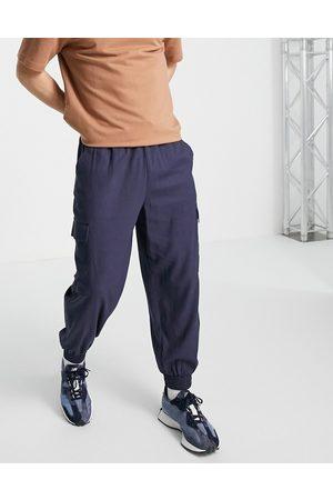 ASOS Marineblå oversized bukser i hørblanding med tapered pasform og cargolommer