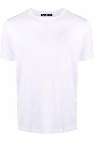 Acne Studios Kortærmede - T-shirt med ansigtsmærke