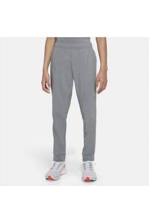 Nike Dri-FIT-træningsbukser i vævet materiale til større børn (drenge)