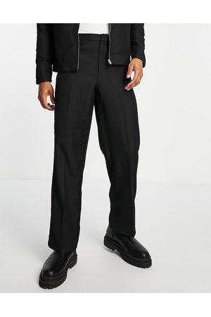ASOS DESIGN Sorte elegante bukser med brede ben og jacquardvævet leopardmønster-Blå