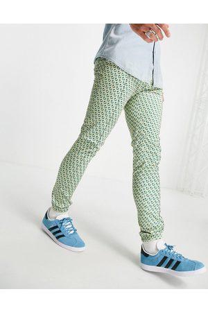 ASOS DESIGN Elegante skinny-joggingbukser i pastelfarvet geometrisk print - Del af sæt