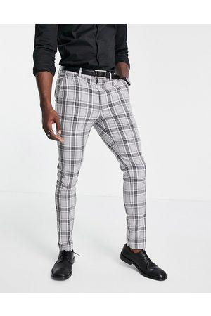 ASOS DESIGN Skinny-habitbukser med Prince of Wales-tern