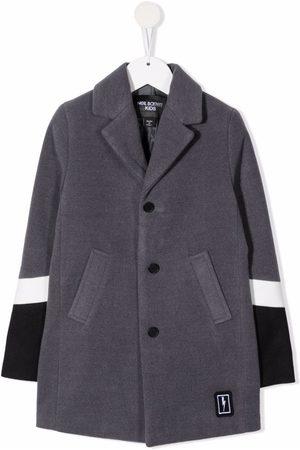 Neil Barrett Enkeltradet frakke med colourblocking