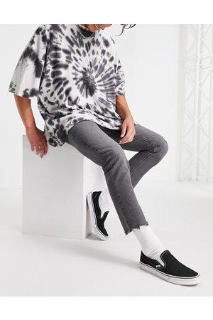 ASOS Slim-jeans med flænger og rå kanter i vasket