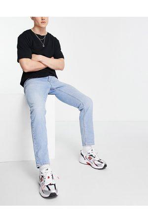 ASOS DESIGN Smalle jeans i lys vintagevasket blå