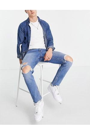 ASOS DESIGN Mænd Slim - Slim-jeans med huller på knæet og rå kanter