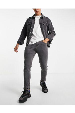 ASOS DESIGN Mænd Slim - Sorte forvaskede jeans med smal pasform fra