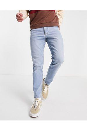 ASOS DESIGN Tapered jeans med stretch i lys vask-Blå