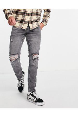 ASOS Slim-jeans med stretch og flænger på knæene i vasket grå