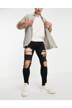 ASOS DESIGN Mænd Stretch - Sorte spray on-jeans med power stretch og store flænger