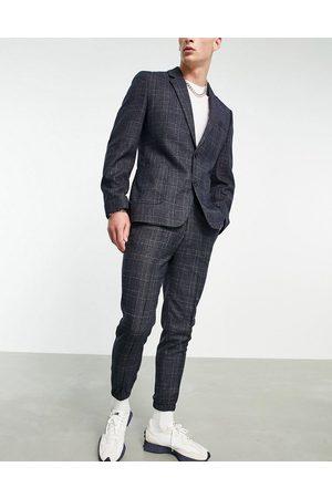 ASOS DESIGN Tapered habitbukser med tætsiddende buksekanter i marineblå tern