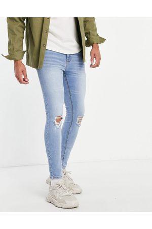 ASOS DESIGN Spray on-jeans med ekstra stretch og flænger på knæene i sart, lys vask-Blå
