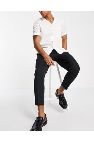 ASOS DESIGN Sorte smarte bukser i tapered stil fra
