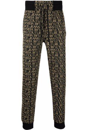 VERSACE Mænd Joggingbukser - All-over logo print sweatpants