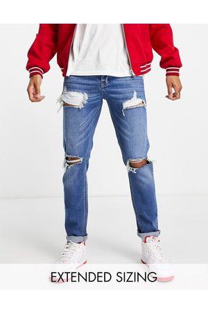 ASOS Mænd Slim - Mørkeblå slim-jeans med store flænger og stretch