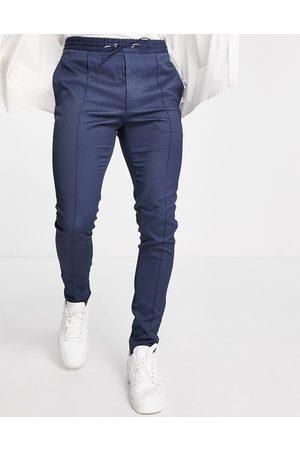 ASOS Elegante, teksturerede skinny-bukser med løbesnor i taljen i marineblå