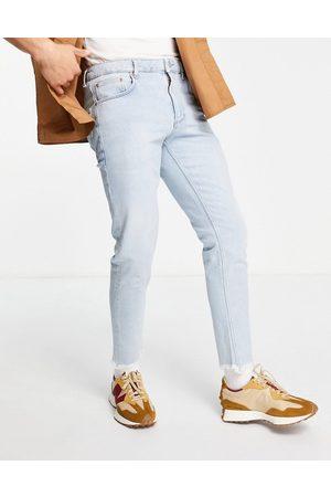 ASOS Slim-jeans med stretch i lys vintagevask med rå kanter-Blå