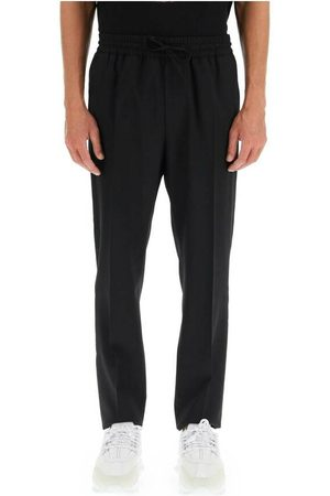 VERSACE Informal wool trousers with embroidery