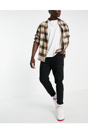 New Look Sorte tilspidsede jeans fra